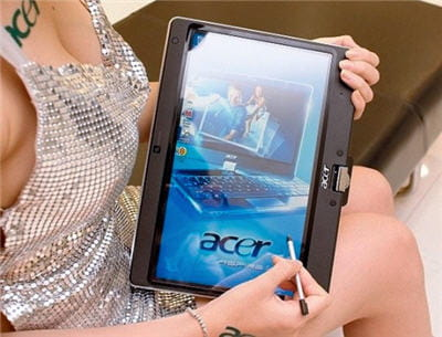 en photo, un netbook-tablette tactile d'acer (écran pivotant sur le clavier)
